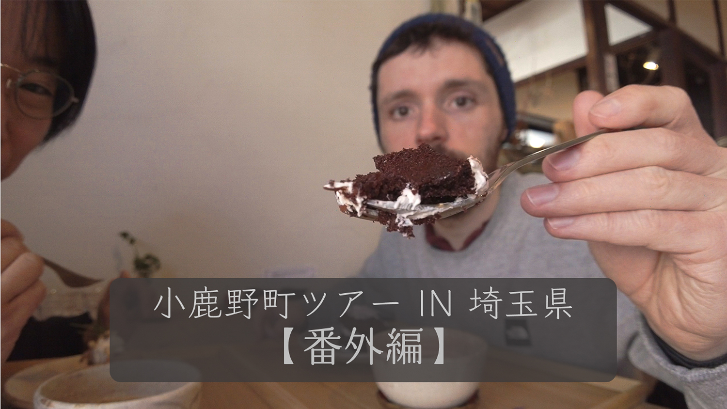 Man showing cake on a fork